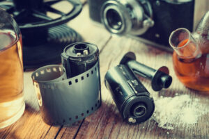 Old photo film rolls, cassette, retro camera and chemical reagen