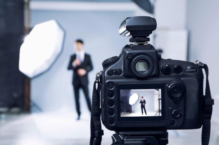 Closeup view of professional camera in studio