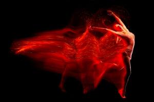 Fine art portrait of beautiful woman dancer in red sparkles